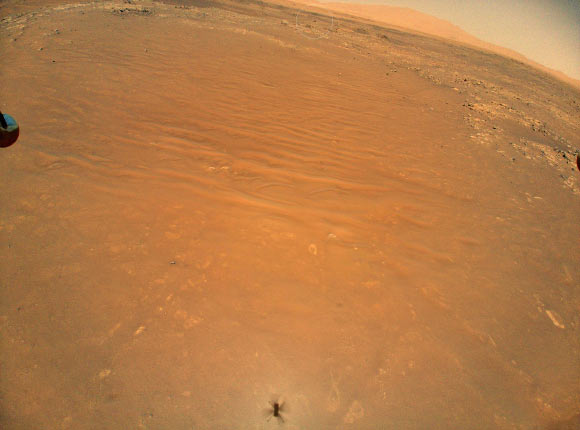 Ingenuity Helicopter Captures Image of Perseverance Rover