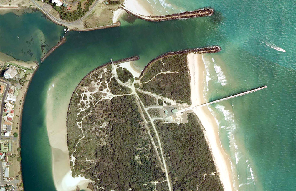 Impacts of coastal protection structures take place over decades